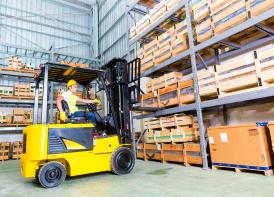 Lantra lift truck being used to move some merchandise inside a warehouse